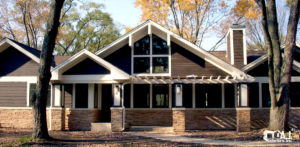 Ranch Home with Dark Brown Fiber Cement Siding and Brick Exterior