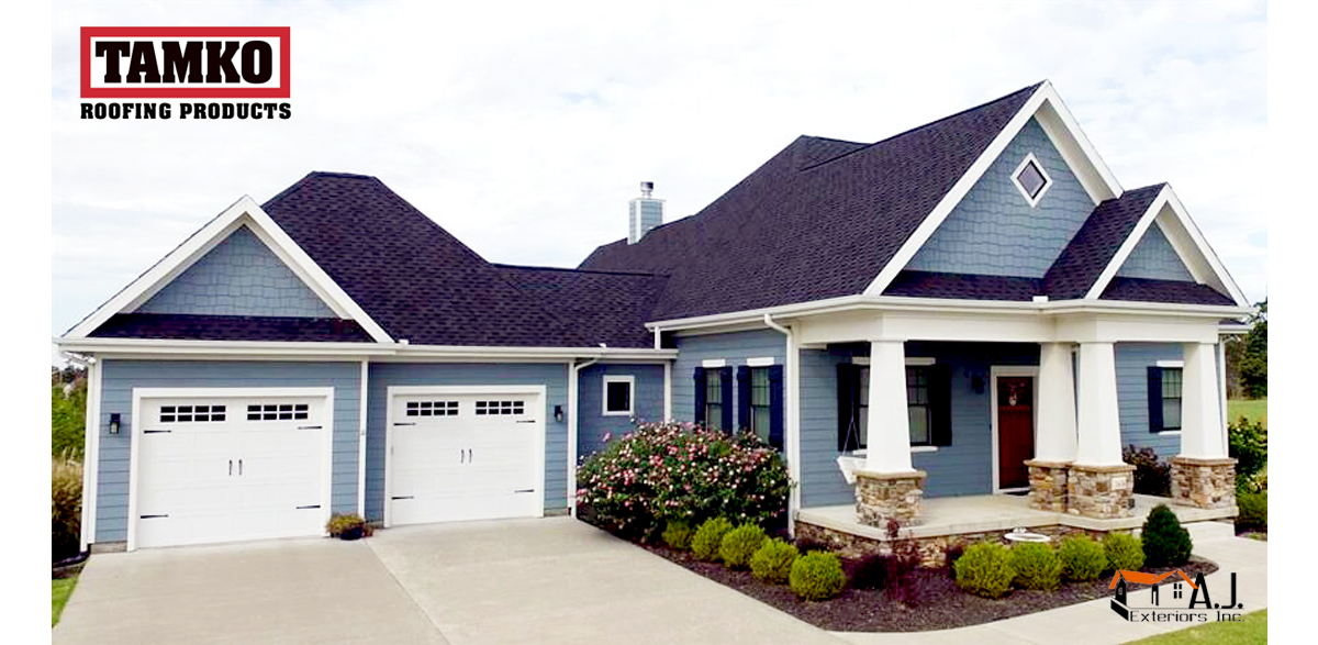 Tamko Brand Dark Gray Roof Shingles Installed on a Blue House